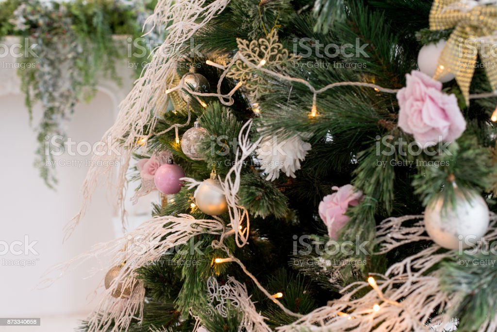 Christmas tree toys and a deer on a branch of an artificial Christmas tree stock photo