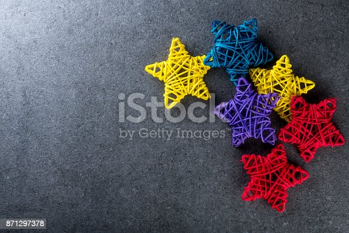 istock Christmas tree toys - colored vine stars. New year and x-mas theme mockup 871297378