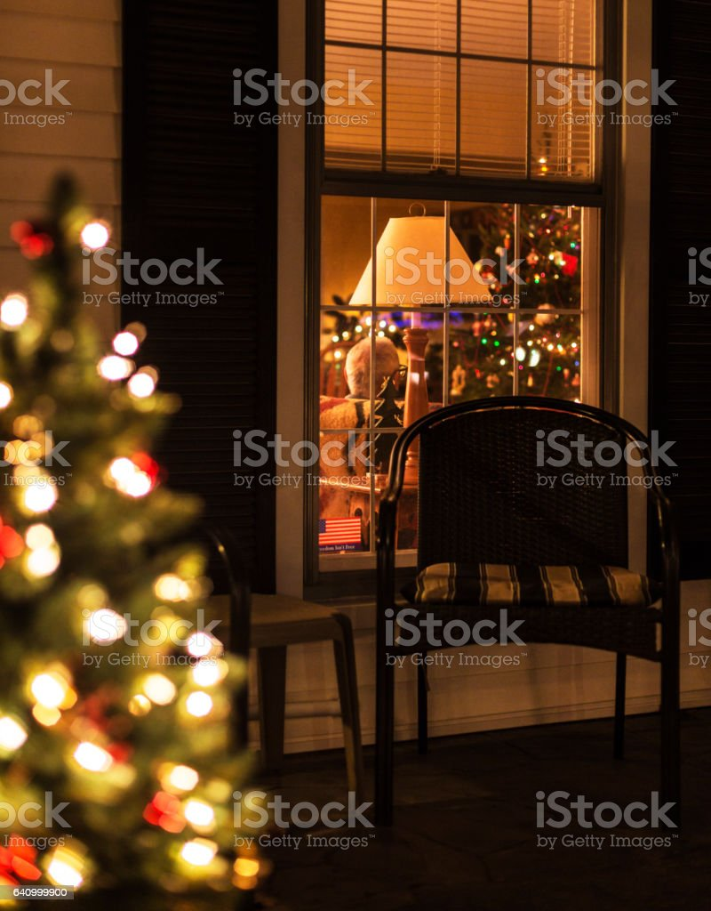 Christmas Tree View Through Window Into Grandpas Living Room Stock