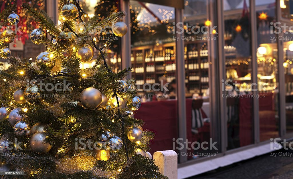 Christmas tree with a restaurant in the backround