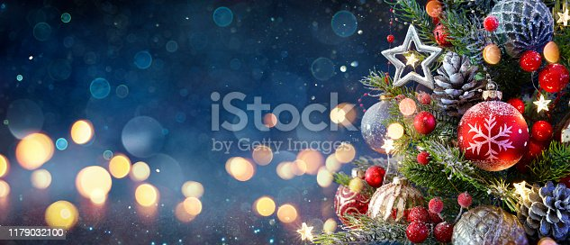 istock Christmas Tree With Baubles And Blurred Shiny Lights 1179032100