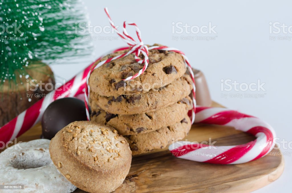 Christmas Tree With Biscuits And Candies On Wooden Board Stock Photo