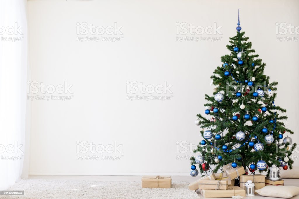 Christmas Tree With Blue In A White Room With Toys For Christmas Stock Photo Download Image Now Istock