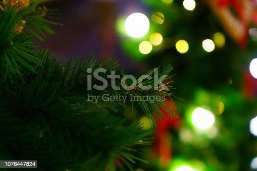 istock Christmas Tree with bokeh light 1076447824
