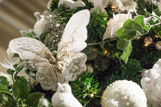 christmas tree with butterfly's and birds stock photo
