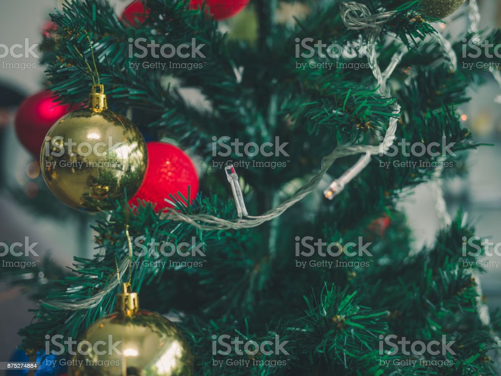 christmas tree with colorful balls blurred background. stock photo