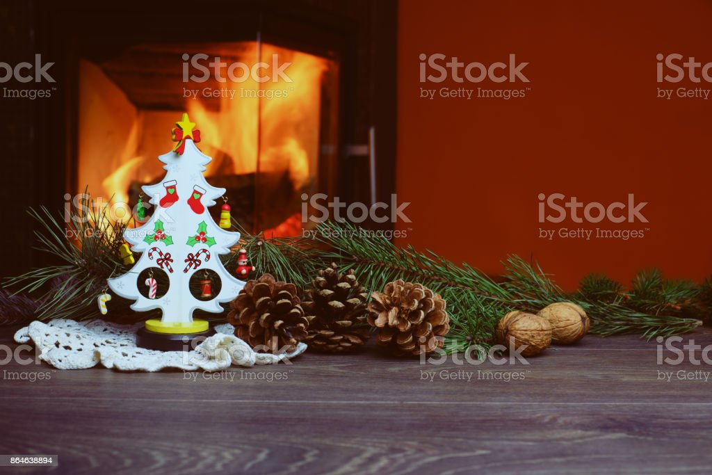 Christmas Tree With Cones By Burning Fireplace Stock Photo