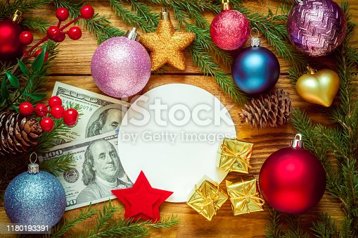Christmas tree with decoration on a wooden board. Christmas toy. New year. Greeting card and dollars
