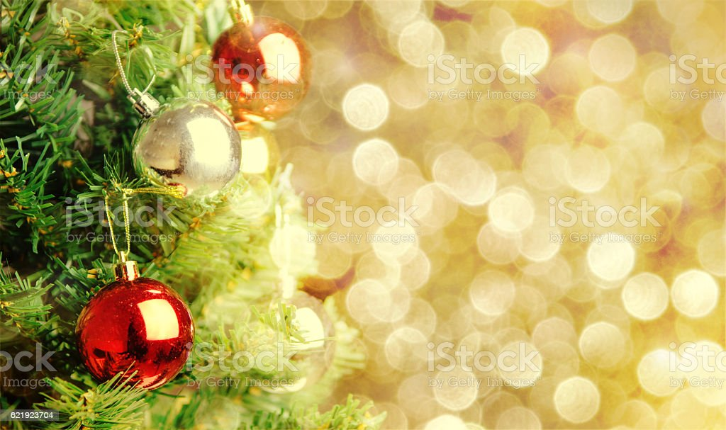 Christmas tree with defocused lights decorated background. stock photo