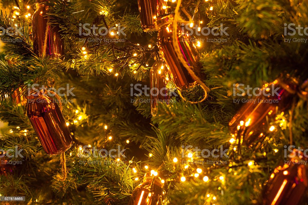 christmas tree with golden bottle stock photo