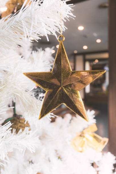 Christmas Tree with golden Star and white Background stock photo
