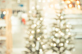 Christmas tree with light string and ball decoration at abstract blur home interior bokeh background,Backdrop for winter festive holiday celebration concept