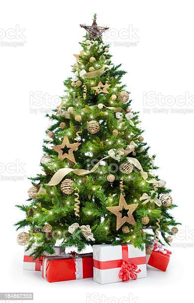 Photo of christmas tree with lights and gifts isolated on white