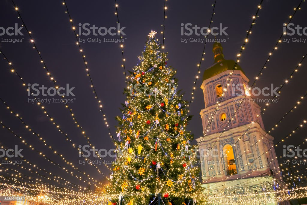 Christmas tree with lights outdoors at night in Kiev stock photo
