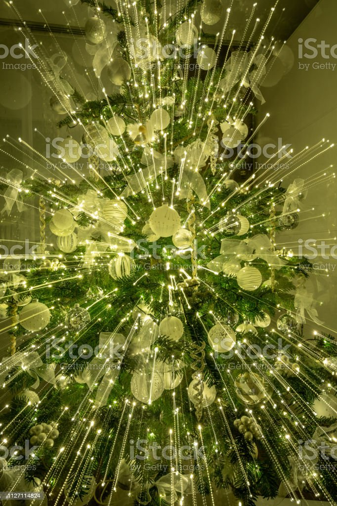 A christmas tree with lots of lights stock photo