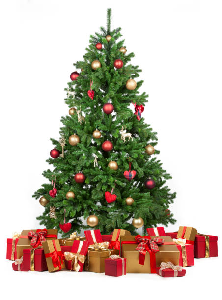Christmas tree with many presents under it stock photo