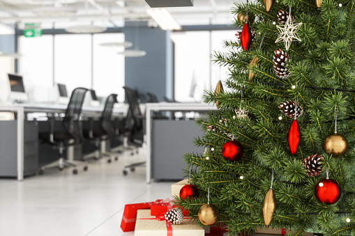 Christmas Tree With Ornaments And Gift Boxes In The Office