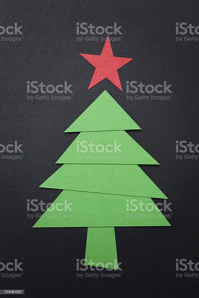 Christmas tree with paper isolated on black background royalty-free stock photo
