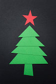 Christmas tree with paper isolated on black background