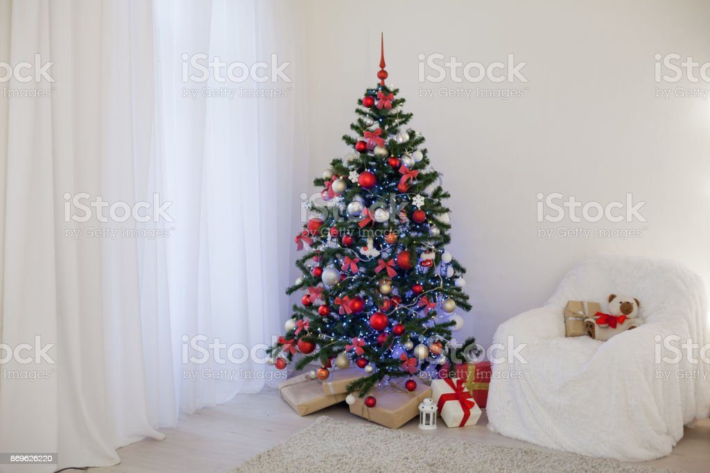 Christmas Tree With Presents In Christmas Lights Room Gifts Stock