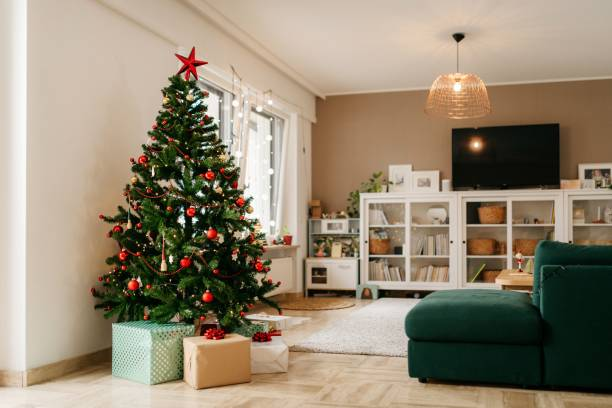Christmas tree with presents in the living room stock photo