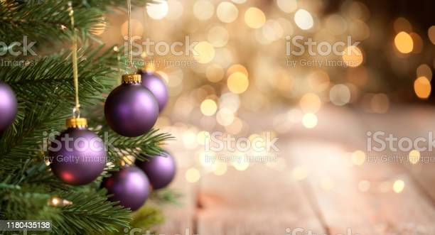 Christmas tree with purple baubles and gold lights background picture id1180435138?b=1&k=6&m=1180435138&s=612x612&h=k13ooepphb psbunancfmkjdnlqo15howd9cugimzqe=