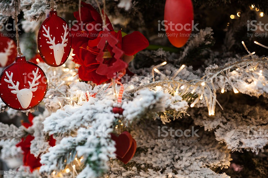 christmas tree with red trees and snow stock photo