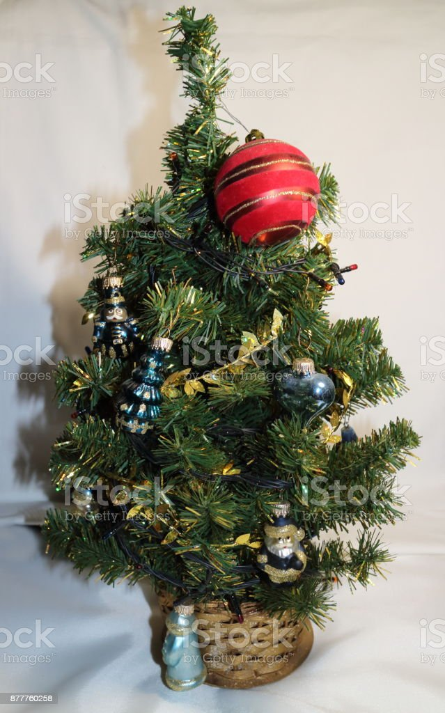 Christmas tree with small toys and a red ball stock photo