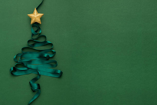 christmas tree with star - christmas green stock photos and pictures