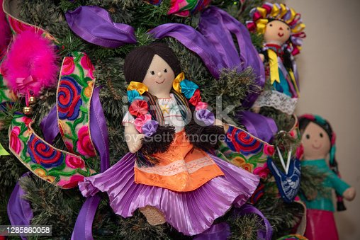 Christmas tree with traditional Mexican decorations, rag dolls, traditional colored ribbons of Mexican culture