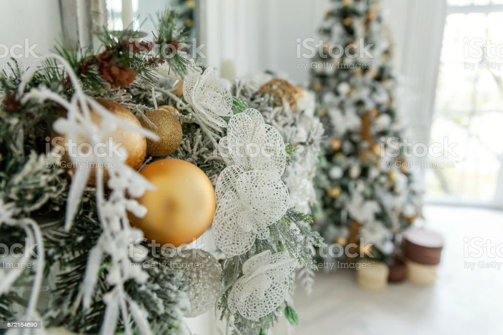 White Christmas Tree With Gold Decorations.Christmas Tree With White And Gold Decorations Stock Photo