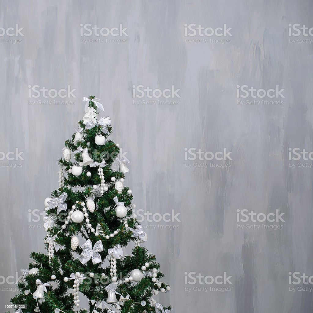 Christmas Tree With White Decorations On A Grey Texture Background Stock Photo Download Image Now Istock