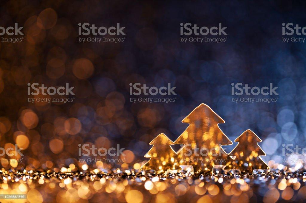 Christmas Trees - Defocused Decoration Gold Blue Bokeh royalty-free stock photo