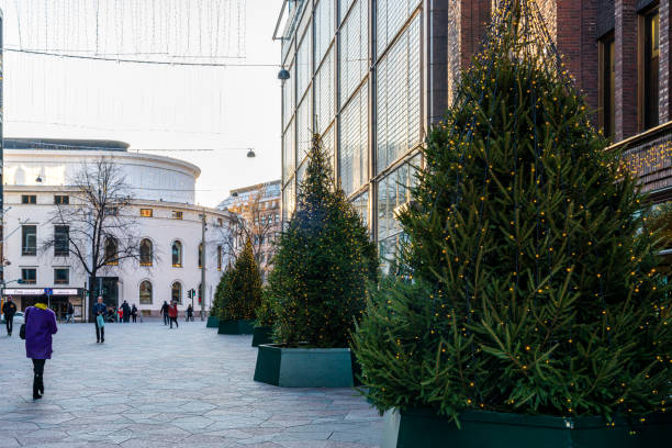 Christmas trees outside the famous Stockmann shopping center building. stock photo