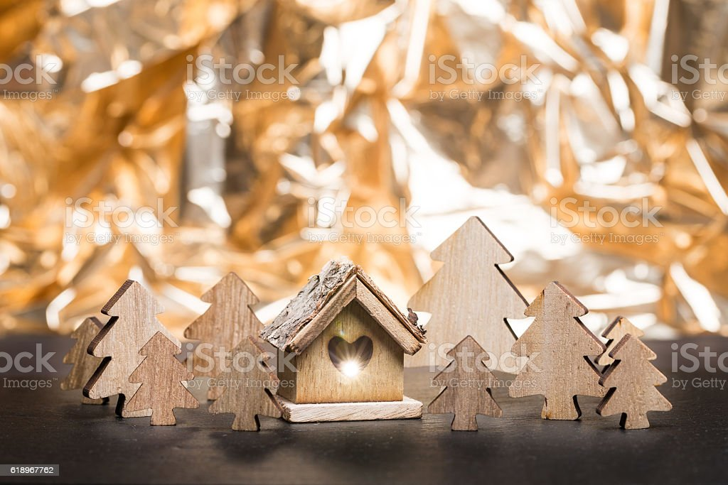 Christmas trees with lighted wooden hut stock photo