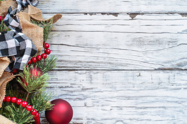 christmas trimmings against white rustic background picture