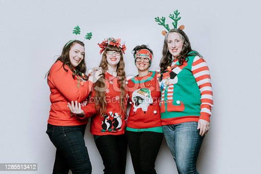 A group of adult women friends celebrate the holiday taking a portrait wearing