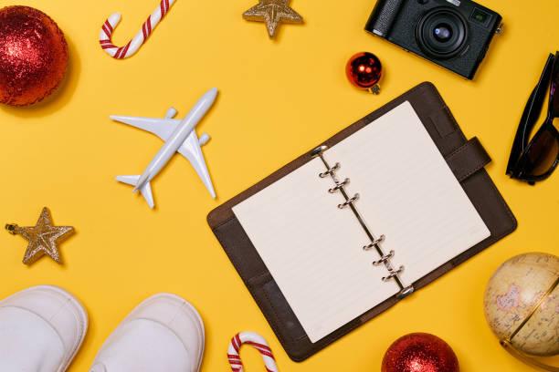 Christmas vacation concept airplane camera notebook passport on picture id884359600?b=1&k=6&m=884359600&s=612x612&w=0&h=or6n5dvi oepq18ufv wztv chvdpldvga1v6rz6jgu=