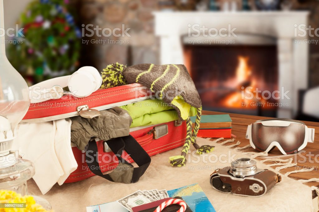 travel suitcase near fireplaces in winter time