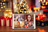 istock Christmas video call with the family. Concept of families in quarantine during Christmas because of the coronavirus 1287056540