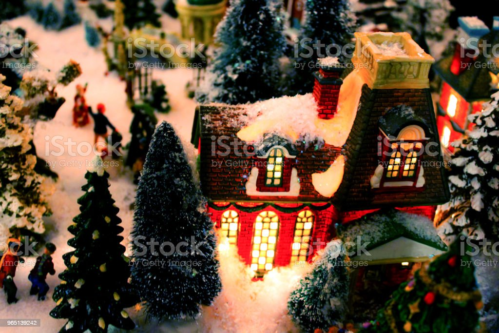 Christmas Village detail with lit building and snow - selective focus zbiór zdjęć royalty-free