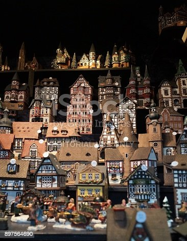 Cologne, Germany – December 16, 2017: A vendor sells authentic handmade European Christmas village sets at the Christmas market.