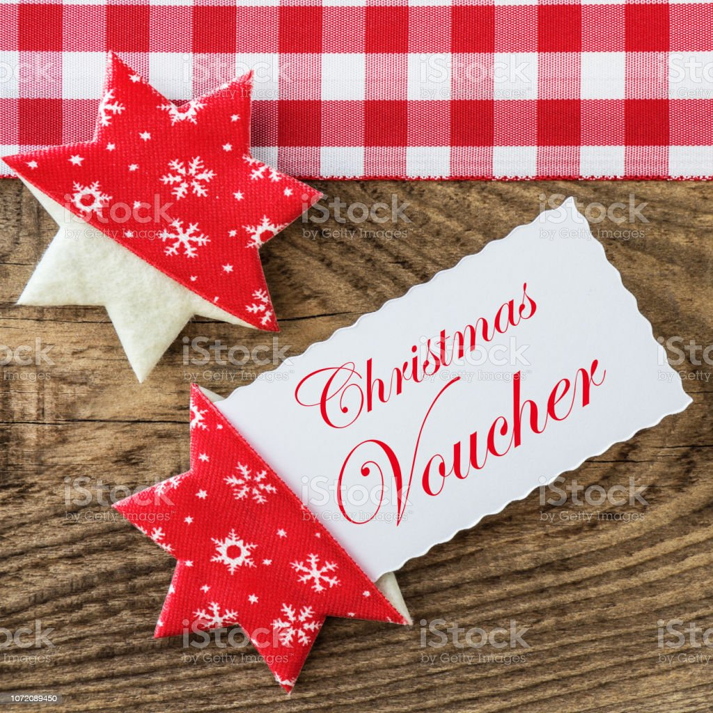 Christmas Voucher against a wooden background