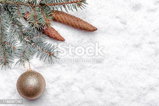 Christmas white background with snow, fir branch and bauble, christmas banner, copy space