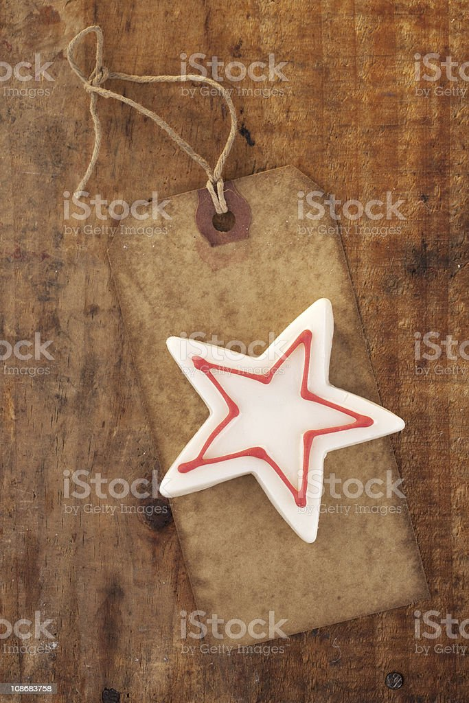 christmas white star candy on retro paper tag royalty-free stock photo