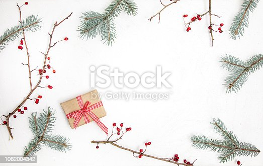 istock Christmas white wood background with christmas decoration 1062004342