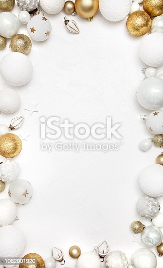 istock Christmas white wood background with  white and gold decoration 1062001920
