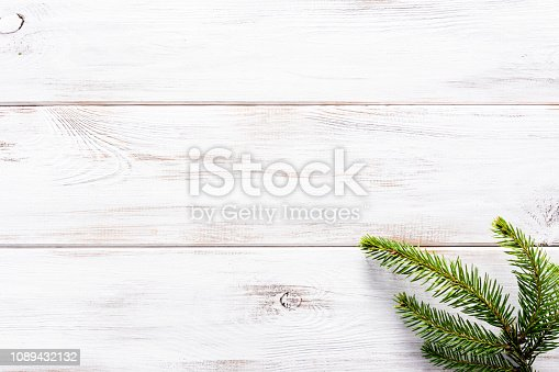 Christmas white wooden background with christmas fir on rustic wood, flatlay, top view