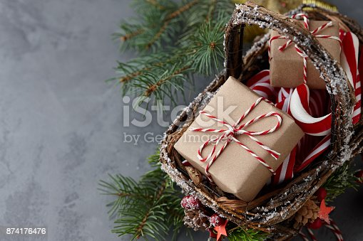 istock Christmas wicker basket with gifts or present boxes 874176476