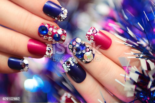 istock Christmas winter blue manicure . 629102662